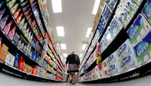A shopper walks down an aisle in a newly opened Walmart Neighborhood Market in Chicago September 21, 2011.