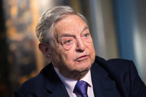 George Soros, billionaire and founder of Soros Fund Management LLC, speaks during a Bloomberg Television interview at his home in London, U.K., on Wednesday, March 12, 2014.