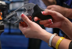 A buyer examines a Smith & Wesson .380 caliber revolver at the Shooting Hunting and Outdoor Tradeshow in Las Vegas in January.