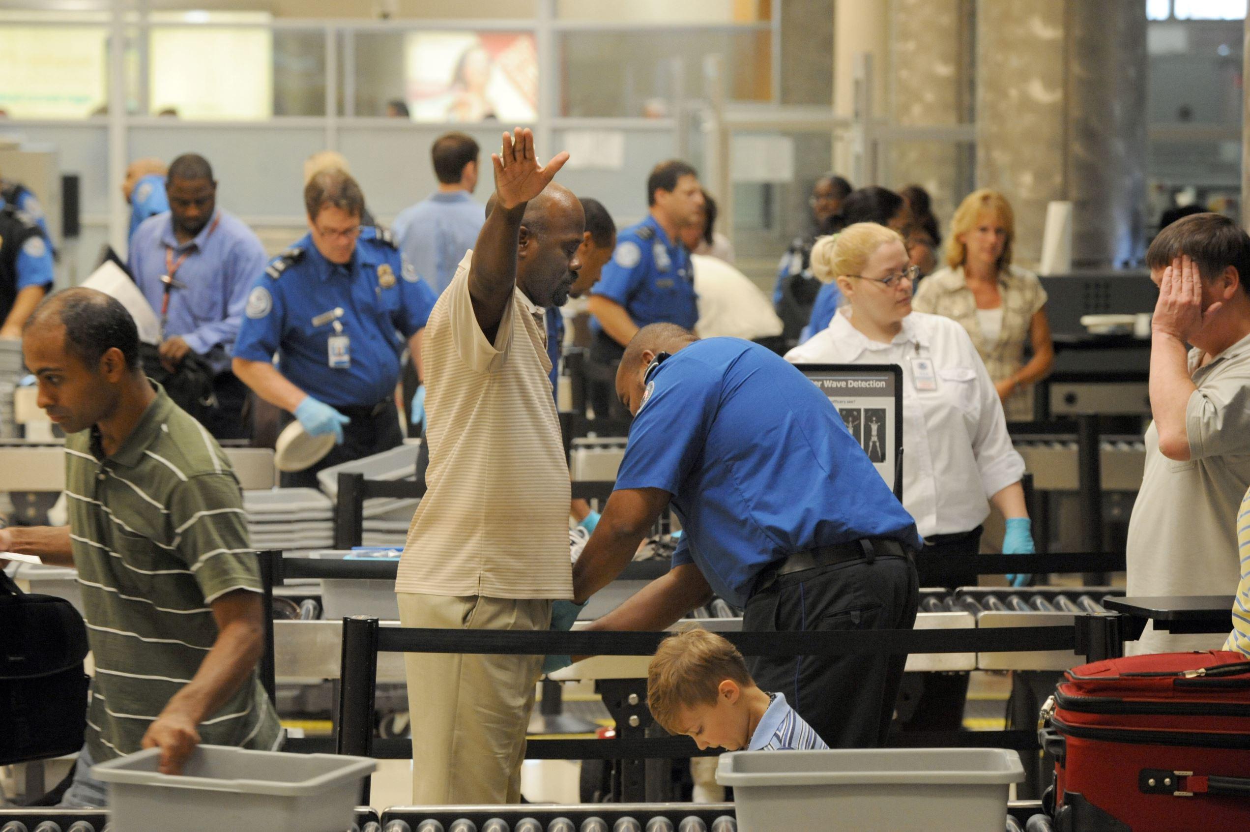 Passengers at a TSA security checkpoint at Hartsfield-Jackson Atlanta International Airport, August 3, 2011 in Atlanta.
