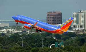 In this May 15, 2014 photo, a Southwest Airlines Boeing 737-700 takes off from Tampa International Airport in Tampa, Fla. Southwest Airlines reports quarterly financial results on Thursday, Oct. 23, 2014.