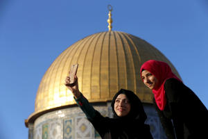 "Salma Salame (L), 27, from the Arab-Israeli town of Baqa al-Gharbiyye, takes a selfie photo with a friend in front of the Dome of the Rock on the compound known to Muslims as Noble Sanctuary and to Jews as Temple Mount, in Jerusalem's Old City, during the holy month of Ramadan, July 4, 2015. This is Salame's third visit to the compound. Palestinians young and old have jumped on a trend for taking ""selfies"" at Al Aqsa, the 8th century Muslim shrine in Jerusalem, both as a personal memento and for relatives prevented from or unable to visit the ancient compound."