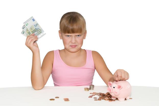 Διαφάνεια 3 από 19: Upset baby  girl with money in hand and piggy bank on table isolated