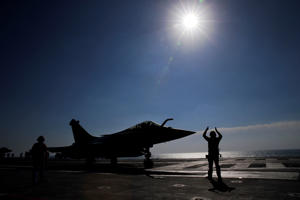 A Rafale jet fighter is catapulted for launch from France's flagship Charles de Gaulle aircraft carrier in the Persian Gulf on Tuesday, Jan. 12, 2016. The carrier joined the U.S.- led coalition against Islamic State in November, as France intensified its airstrikes against extremist sites in Syria and Iraq in response to IS threats against French targets.
