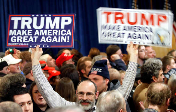 Supporters wait for Republican presidential candidate, businessman Donald Trump to speak during a primary night rally, Tuesday, Feb. 9, 2016, in Manchester, N.H.