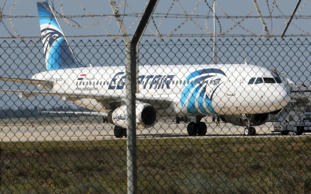 A hijacked Egypt Air A320 airbus stands on the runway at Larnaca Airport in Larn...