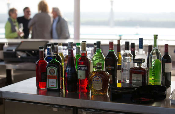 People enjoy the bar and facilites on the top deck onboard the cruise ship