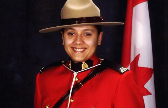 Slide 1 of 15: RCMP Const. Sarah Beckett is shown in this RCMP handout photo.