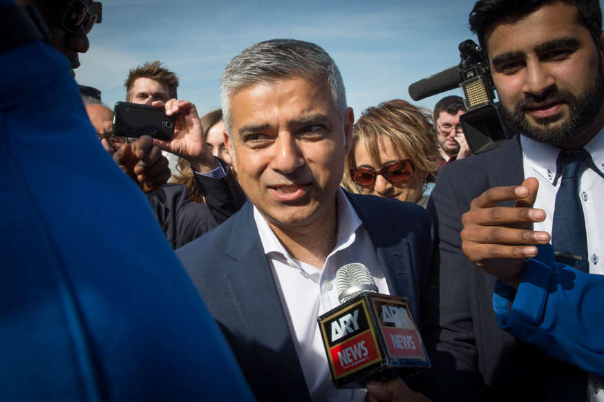 Labour mayoral candidate Sadiq Khan arrives at City Hall in London with his wife Saadiya (behind) as counting continues on votes for the Mayor of London and the London Assembly elections.