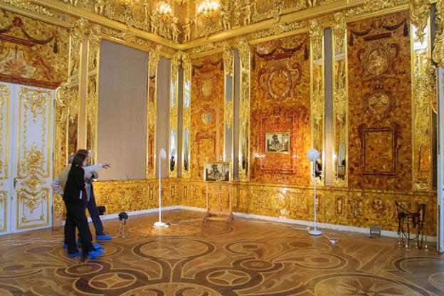 Slide 2 of 14: The Amber Room, located in the Catherine Palace of Tsarskoye Selo near Saint Petersburg, is a chamber whose interiors were crafted out of amber, gold leaf and precious stones for the Tsars. It was looted by German troops during World War II and the room was relocated and put on display in KA?nigsberg Castle (then a part of Germany but now in Kaliningrad, Russia) during the remaining war years. However, the treasure disappeared after the war ended and the hunt is still on for the missing contents of the room.