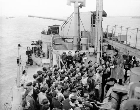 "Slide 1 of 31: Lieut. Commander D.W. Pifers, D.S.C., R.C.N., of Halifax, commanding Officer of H.M.C.S. ""Algonquin,"" one of Canada's newest most powerful destroyers, briefs his ship's company, while on route to the invasion beachhead in 1944. (AP Photo)"