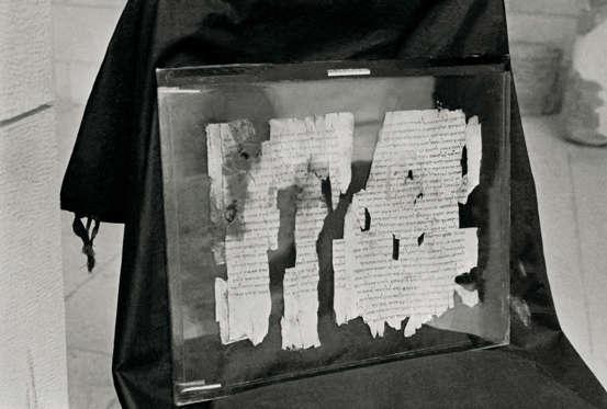 Διαφάνεια 9 από 27: (Original Caption) This is a close-up of pieces of the Dead Sea Scroll, called 'The Manual of Discipline' which describes 'A Covenant of Steadfast Love' in which members of a dedicated community are united with God. It tells of 'The Two Spirits of Man,'