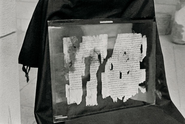 (Original Caption) This is a close-up of pieces of the Dead Sea Scroll, called 'The Manual of Discipline' which describes 'A Covenant of Steadfast Love' in which members of a dedicated community are united with God. It tells of 'The Two Spirits of Man,'