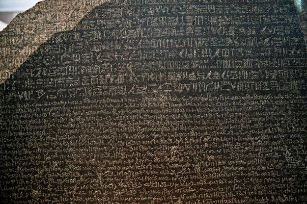Διαφάνεια 14 από 27: The Rosetta Stone is an ancient Egyptian granodiorite stele inscribed with a decree issued at Memphis in 196 BC on behalf of King Ptolemy V. The decree appears in three scripts: the upper text is Ancient Egyptian hieroglyphs, the middle portion Demotic script, and the lowest Ancient Greek. Because it presents essentially the same text in all three scripts (with some minor differences between them), it provided the key to the modern understanding of Egyptian hieroglyphs.