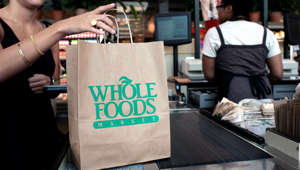 A customer checks out of the Whole Foods Market
