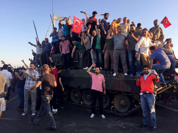 ISTANBUL, TURKEY - JULY 16 : Nearly 50 soldiers occupying Bosphorus Bridge surrender as Istanbulites climb on tanks during 'Parallel State/Gulenist Terrorist Organization's coup attempt, on July 16, 2016 in Istanbul, Turkey while people are reacting agai