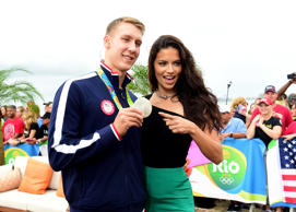 RIO DE JANEIRO, BRAZIL - AUGUST 08:  Model Adriana Lima and swimmer Chase Kalisz of the United States pose for a photo on the NBC Today show set on Copacabana Beach on August 8, 2016 in Rio de Janeiro, Brazil.  (Photo by Harry How/Getty Images)