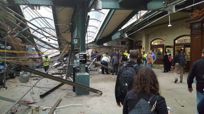 This photo provided by Ian Samuel shows the scene of a train crash in Hoboken, N.J., on Thursday, Sept. 29, 2016. A commuter train barreled into the New Jersey rail station during the Thursday morning rush hour, causing serious damage. The train came to