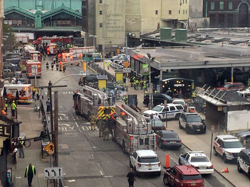Emergency personnel arrive at the scene of a train crash in Hoboken, N.J. on Thursday, Sept. 29, 2016. A commuter train barreled into the New Jersey rail station during the Thursday morning rush hour, causing serious damage. (AP Photo/Joe Epstein)