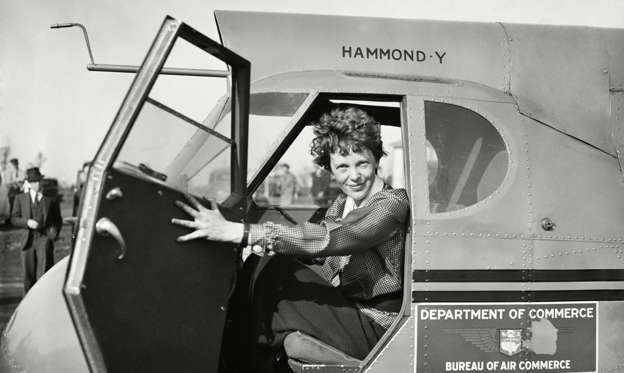 Slide 1 of 14: Amelia Earhart in Department of Commerce airplane, 1936.