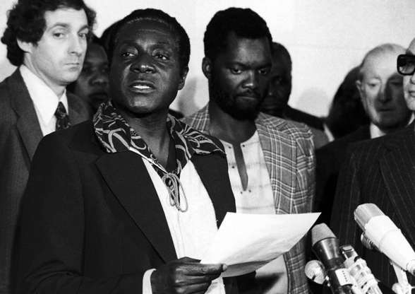 Slide 3 of 26: Robert Mugabe, a founder member of the ZANU, Zimbabwe African National Union, faces the press on his arrival, with his delegation at Geneva Airport in Geneva, Switzerland on Sunday, Oct. 24, 1976. Mugabe, who now claims to be ZANU leader, is the national