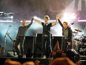 LONDON, UNITED KINGDOM - JUNE 29: Sting, Stewart Copeland and Andy Summers of The Police take a final bow and wave the crowd farewell after performing on stage on Day 2 of 'Hard Rock Calling' on June 29th, 2008, in Hyde Park, London, England. This was th