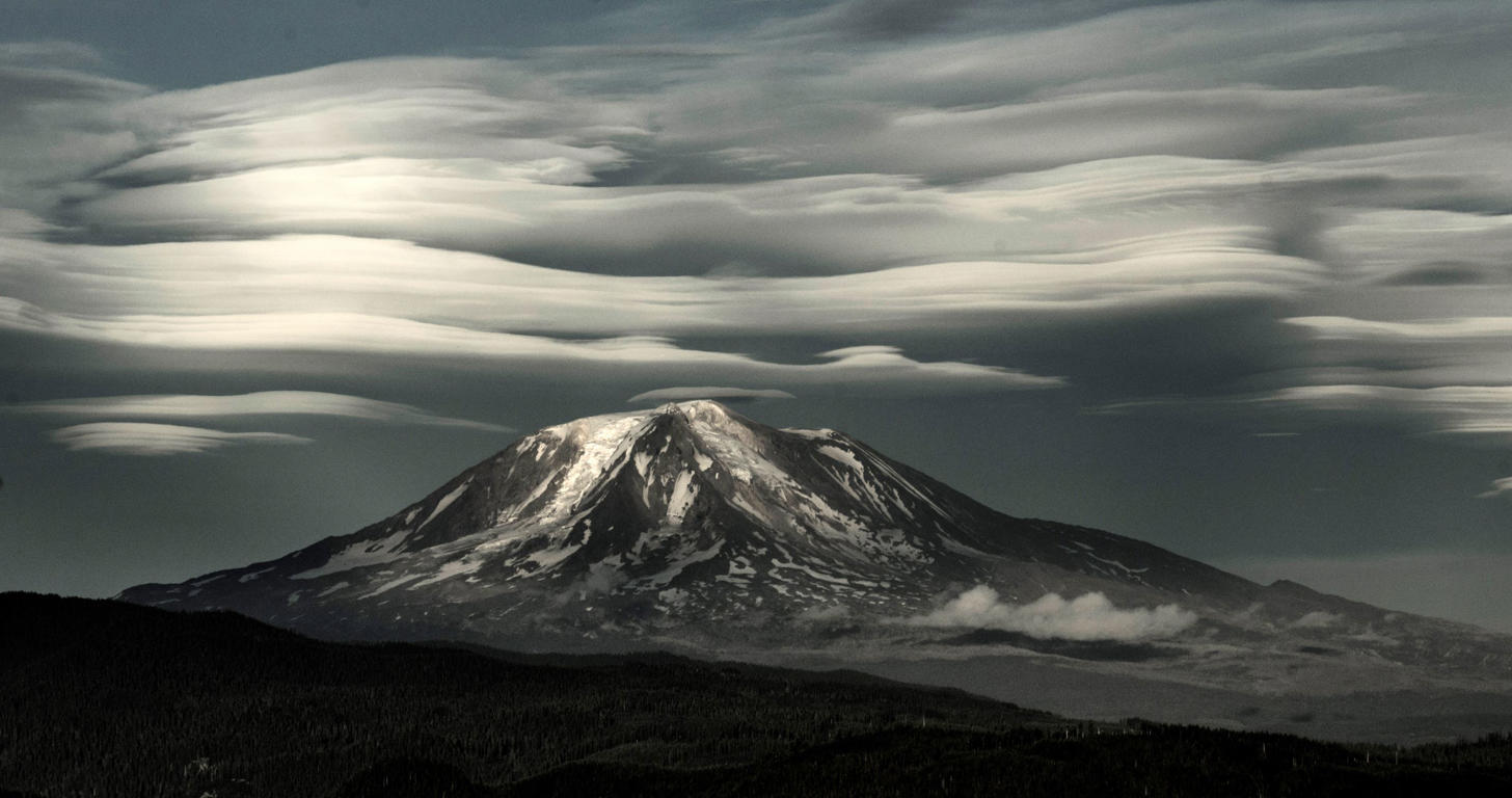 Lenticular clouds over Mt Adams captured at sunset during a hike on the Windy Ridge side of Mt St Helens.