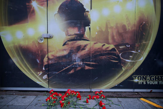 Flowers of the victims of the attack are placed outside a nightclub, which was attacked by a gunman overnight, in Istanbul, on New Year's Day, Sunday, Jan. 1, 2017. An assailant believed to have been dressed in a Santa Claus costume and armed with a long