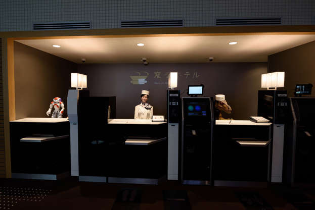 """Slide 2 de 27: Three robots """"man"""" the reception at the Henn-na Hotel in Nagasaki, Japan. They greet you, check you in and even remember conversations they've had with you. Similar robots are already being used at a Singapore college and even hospitals in Belgium."""