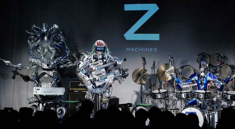 Slide 9 de 27: Motorized drum kits, guitars playing any song you want to an actual band with robots in it, these robot bands are concert ready. They can even change their music style based on audience interactions – all while headbanging.