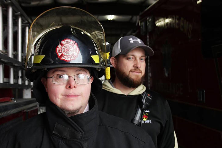 Jason Eagan is a firefighter in Sandoval, Illinois, and has Down syndrome. Lt. Matt Horn, right, says Jason is a valued member of the volunteer department.