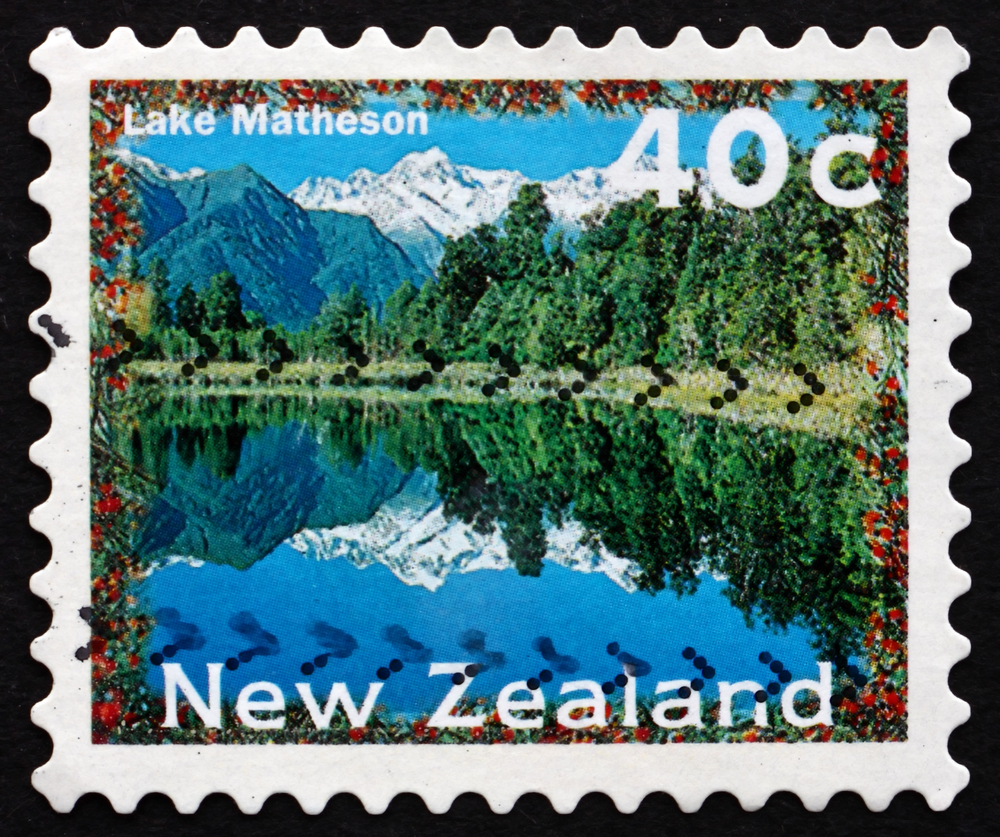 Slide 50 of 70: NEW ZEALAND - CIRCA 1996: a stamp printed in the New Zealand shows Lake Matheson, Scenic View, circa 1996