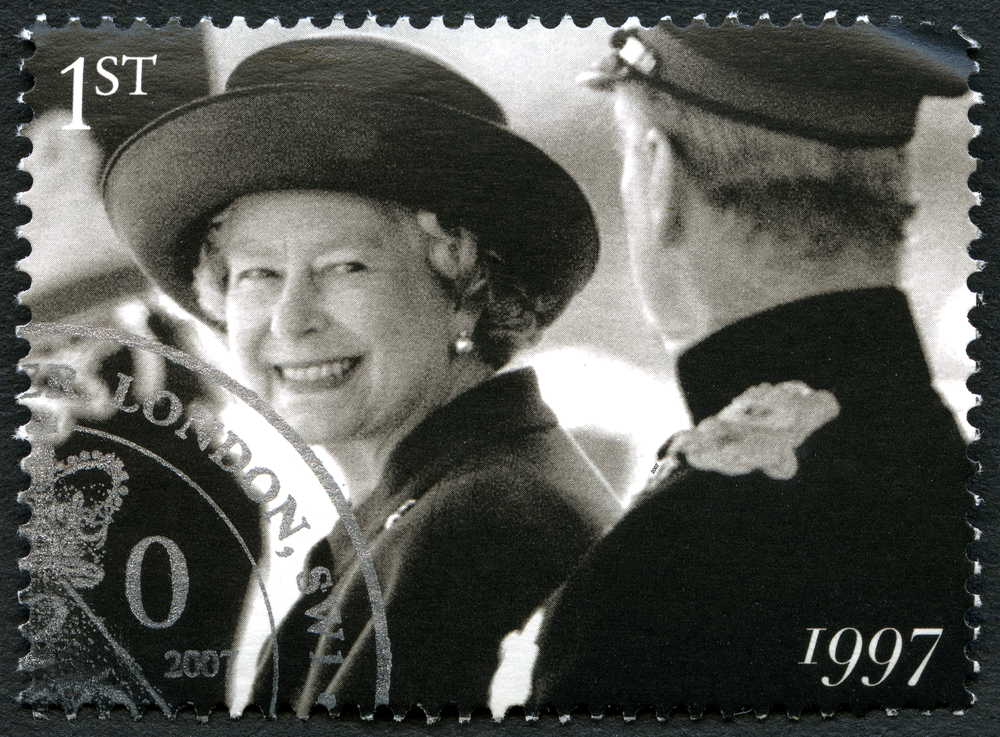 Slide 16 of 70: UNITED KINGDOM - CIRCA 2007: A used postage stamp from the UK, depicting a portrait of a smiling Queen Elizabeth II in 1997, circa 2007.