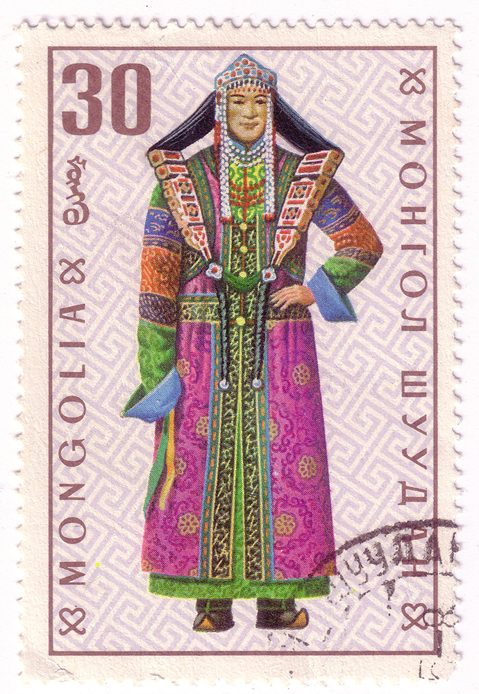 Slide 40 of 70: Mongolia - circa 1969: A post stamp printed in the Mongolian shows image of clothes, series Mongolian national clothes, circa 1969.