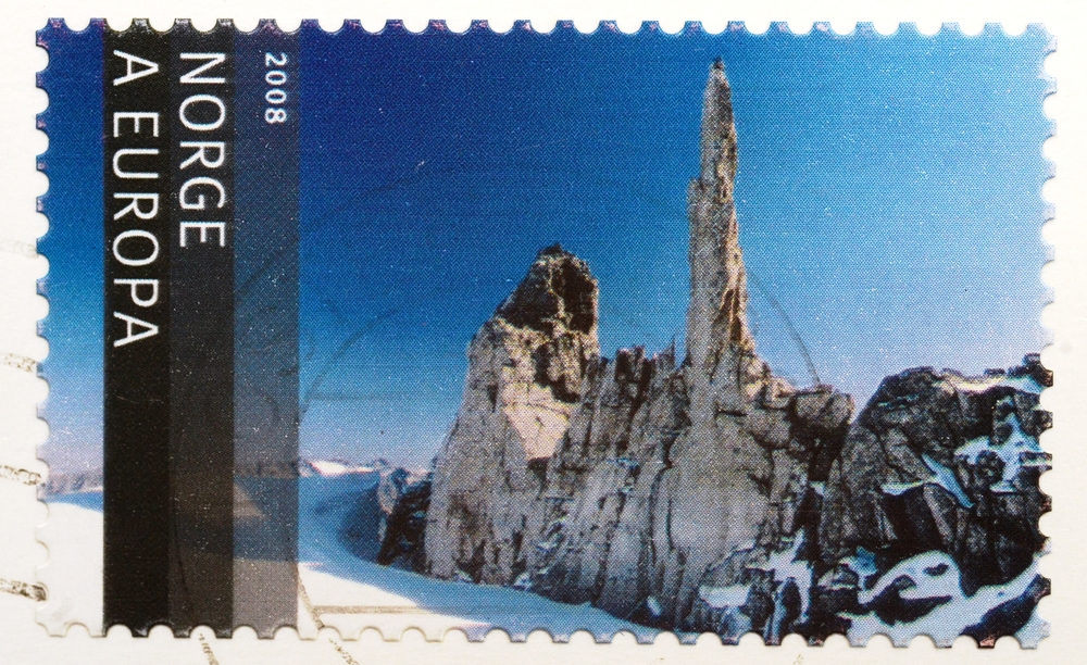 Slide 19 of 70: NORWAY - CIRCA 2008: A stamp from Norway shows image of a mountain landscape with glacier and needle rock formation, circa 2008