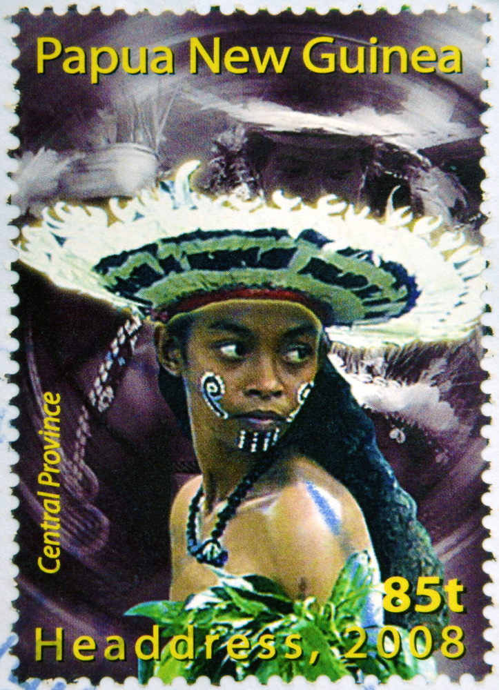 Slide 48 of 70: PAPUA NEW GUINEA - CIRCA 2000: Stamp printed in Papua New Guinea shows a woman in a feathered headdress from the Central Province, circa 2000