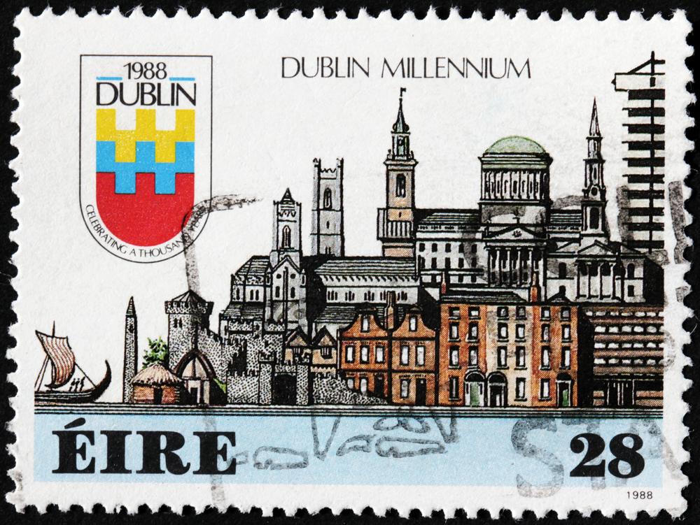 Slide 14 of 70: IRELAND - CIRCA 1988: A stamp printed by IRELAND shows view of Dublin town, circa 1988.