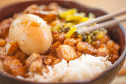 Braised pork and egg on rice. Soy-stewed pork rice. Taiwanese Cuisine