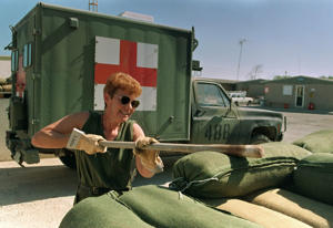 Medical assistant Sgt. Darlene Beggs of Calgary puts up a sand bag barrier outside the Canadian base hospital in Doha, Qatar on Dec. 5, 1990 shortly before the Gulf War. Many soldiers had a rare day off because the CF-18s were not flying.